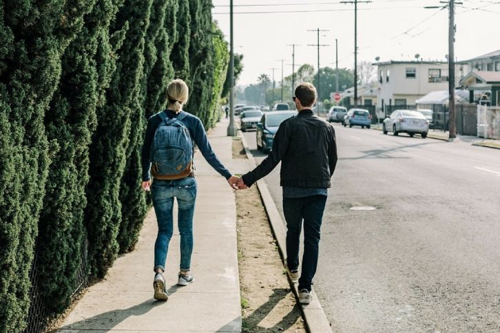 Couple on a Slow Walk on the sidewalk