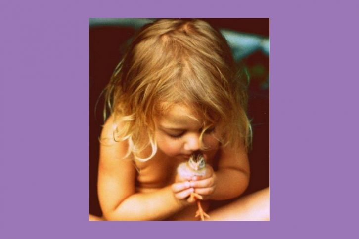 Reverence Young Girl holding Chick